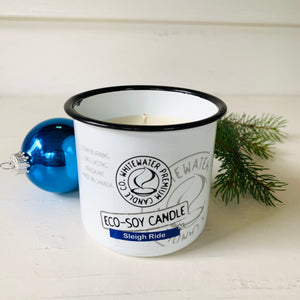 Made in Canada natural scented eco soy candle with a blue Christmas tree ball and a spruce sprig in background.