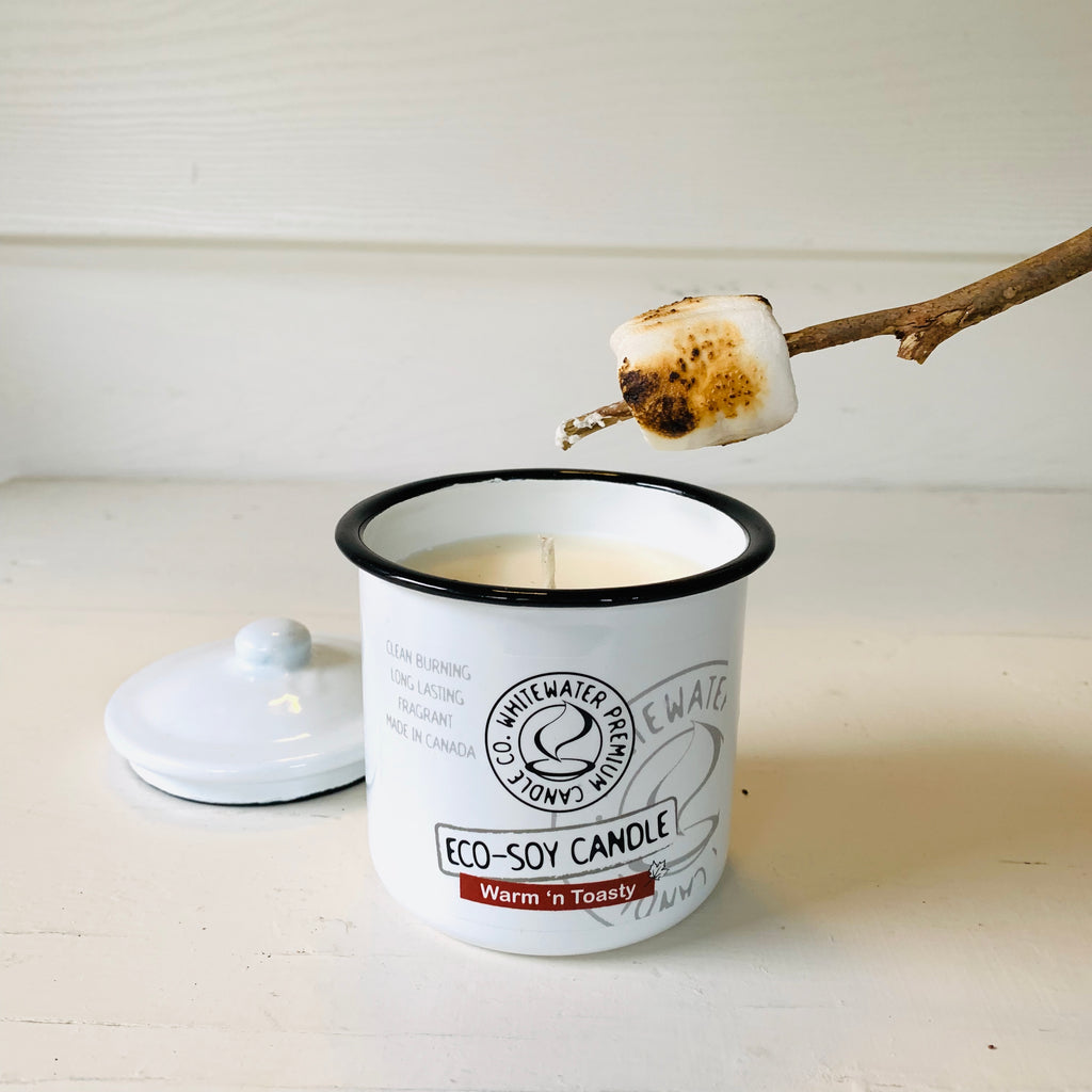 Made in Canada natural eco soy candle, pictured with a roasted marshmallow on a stick.