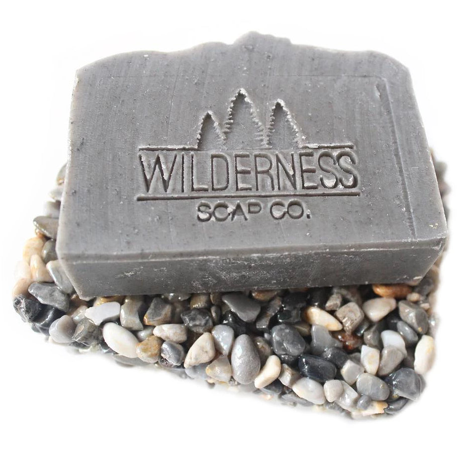 Made in Canada beach pebble soap dish with grey eucalyptus soap on top.