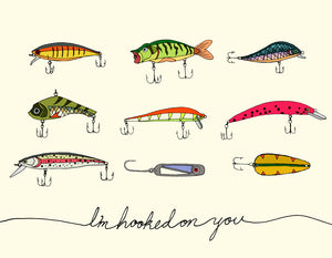 Hand drawn, Made in Canada Love and friendship card with nine colourful fishing lures. Caption reads: I'm hooked on you