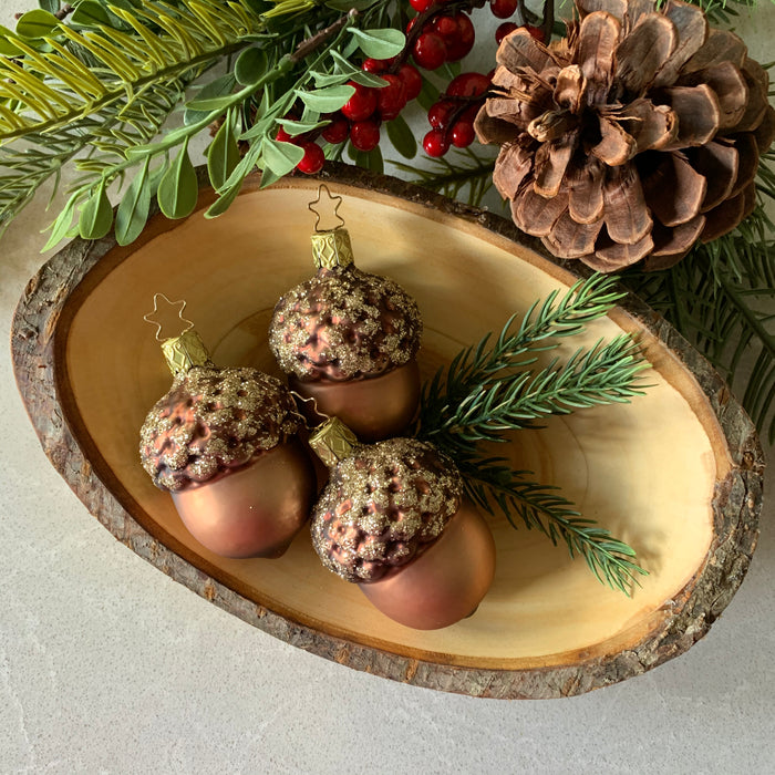 European Ware Haus Gingerbread World Glass Christmas Ornament – Inge-Glas Acorn  Shown with Waldfabrik wooden bowl