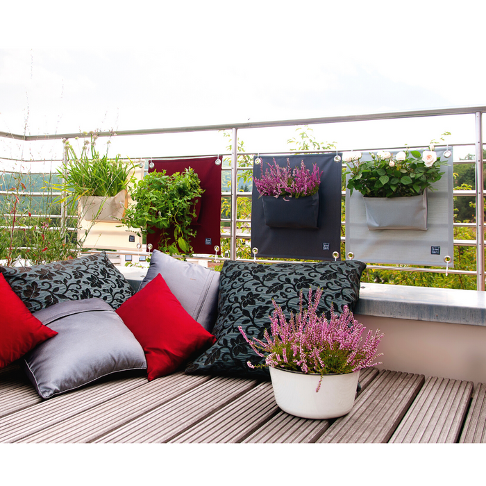 Blooming Walls Canada The Green Pockets Hanging Planters on balcony railings with outdoor cushions