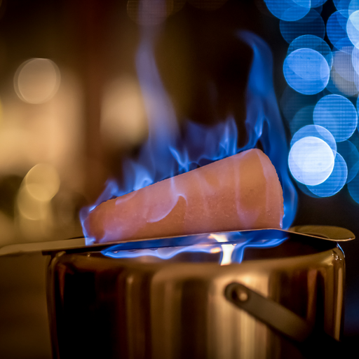 Gingerbread World - Feuerzangenbowle Pot with Flaming Sugar Cone on Tray - Shutterstock web