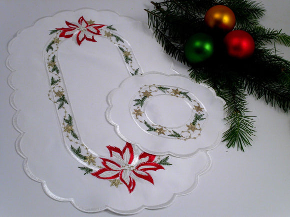 Christmas Table Linens with Poinsetta Motif. Imported from Germany by Gingerbread World
