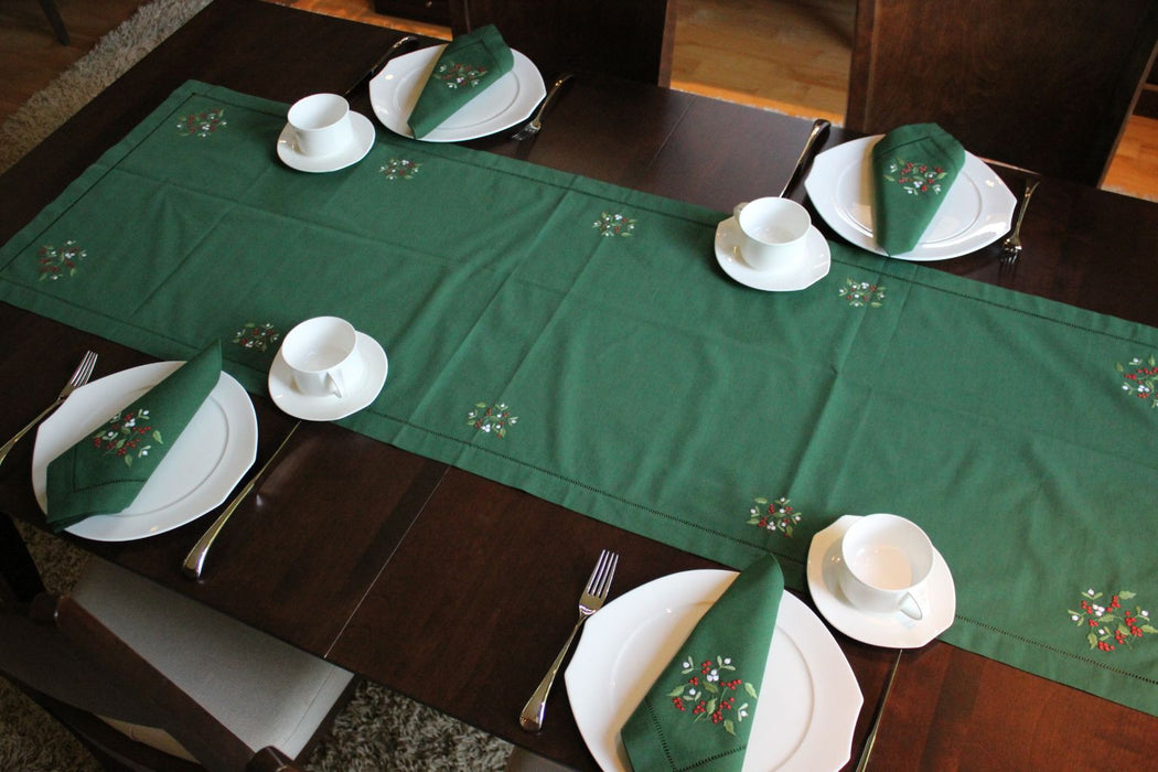 Gingerbread World Christmas Table Linens. 100% cotton napkins, table cloths and table runners with Christmas Mistletoe motif