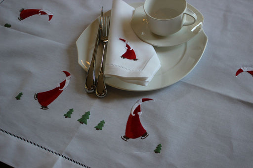 Gingerbread World Christmas Table Linens. 100% cotton napkins, table cloths and table runners with Christmas Santa Claus motif