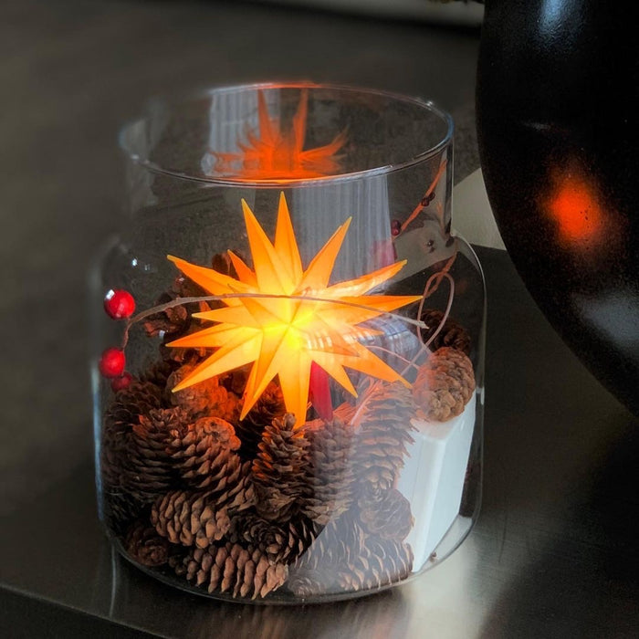 European Ware Haus Herrnhuter Stars Canada - Small Yellow Star displayed in Glass Jar with pine cones