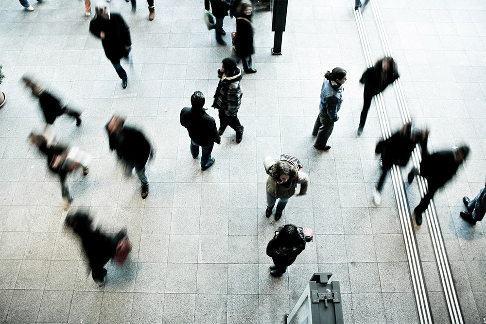 Commuters walking through a station