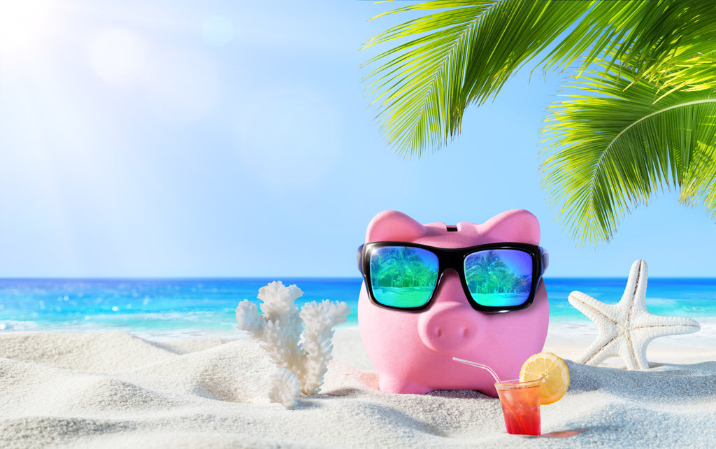 An image of a piggy bank on a beach