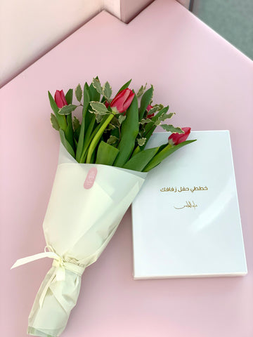 wedding planner book with fuchsia tulips