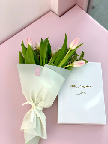 wedding planner book with light pink tulips