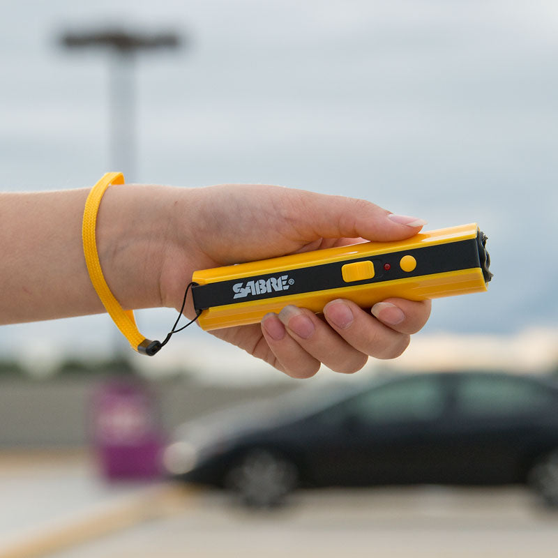 Compact Stun Gun + Flashlight w/ Stop Strap Technology