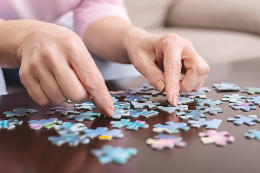 Woman's hands building a jigsaw puzzle