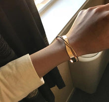 Load image into Gallery viewer, Glossy Double Layer Geometric Irregular Cross Bangle for Women Golden on hand | etrolleys.com