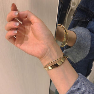 Glossy Double Layer Geometric Irregular Cross Bangle for Women Golden on Hand | etrolleys.com