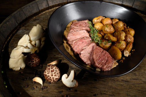 Slices of Roast Beef with sauce and Cocotte Potatoes