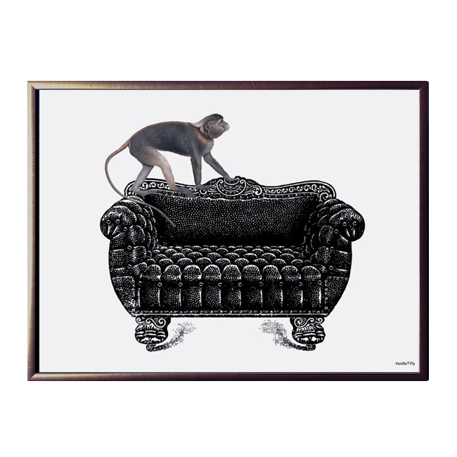 Monkey On Couch Framed Print