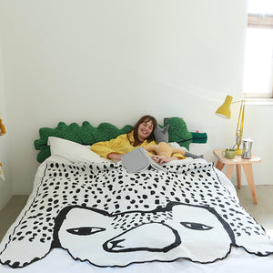 bear-shaped-throw-by-donna-wilson-lifestyle-image-of-bear-throw-on-a-bed