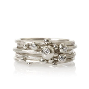 Delphis Rings. Set of 5. With 3 brilliant cut diamonds. Total 0,04 ct. F/G, vs, Ex. cut.
