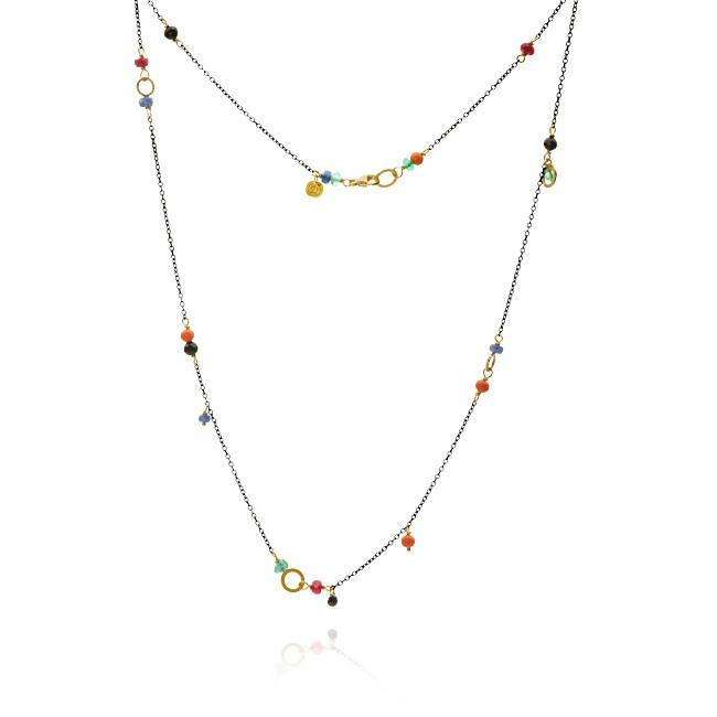 Piccolo necklace. With gold 18 K, 1 black diamond. 0,30 ct. coral, spinel, sapphire, ruby and emerald, 47 cm.