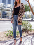 Kakimoda Wearing A Tan Leopard Knitted Cardigan