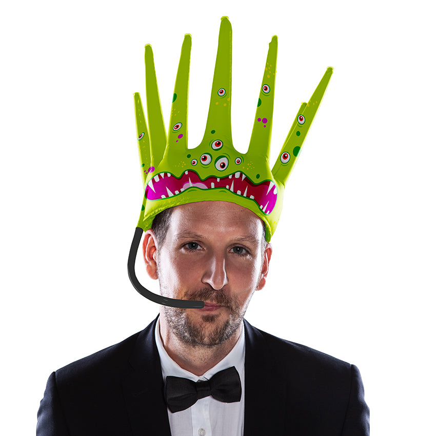 The Trötenkrone or Party Blower Crown is the ultimate Fan Hat, the perfect Party Hat which creates a Sound. The funniest Accessoire you've seen so far. Innovative Merchandise! Stay Gold!