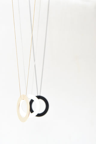Image of two ring necklaces from the Pursuits collection