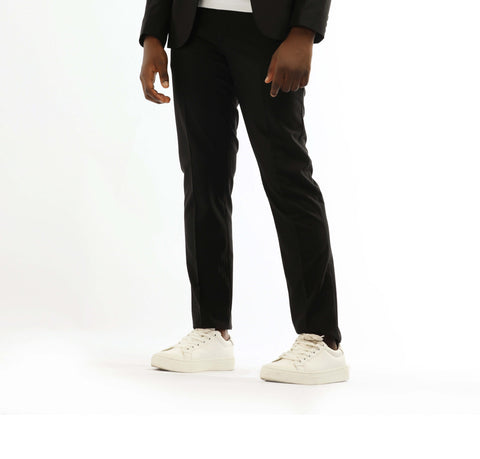 black trousers and white sneakers