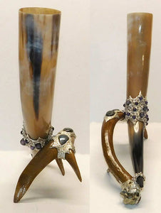 Deer antler holding a drinking horn with black pearls