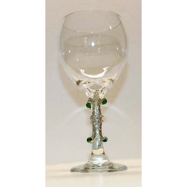 Emeralds on red wine glass side b