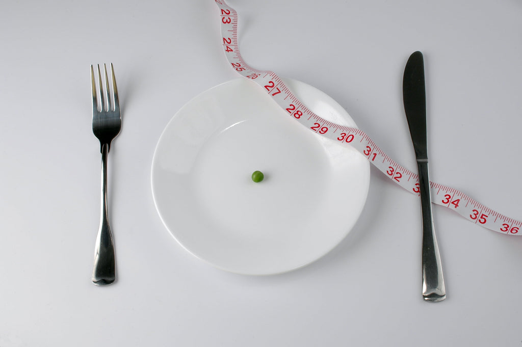 Extreme diet with pea and tape measure