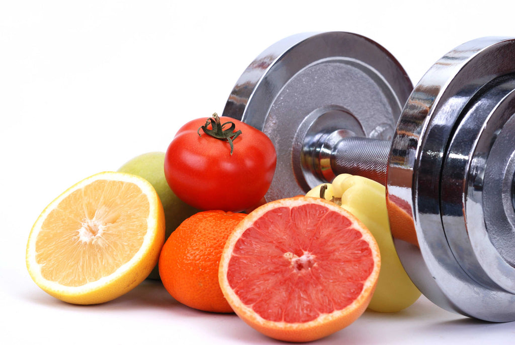 assorted-fruits-next-to-a-dumbell