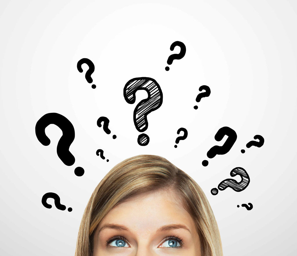 woman thinking with question marks above her head