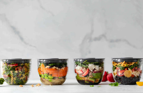 4 meal prep containers with food in them