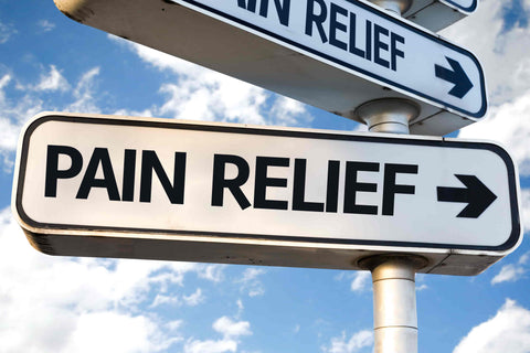 a sign that reads pain relief with a blue sky and clouds in the background