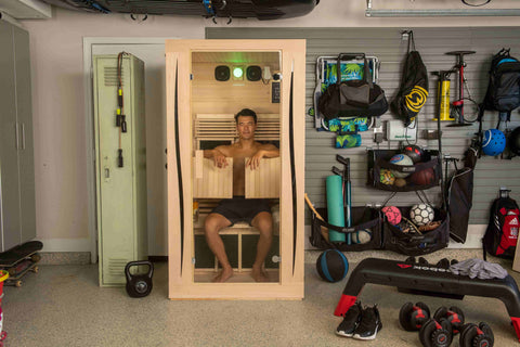 man enjoying an infrared therapy session inside an infrared sauna by JNH Lifestyles