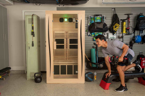 man performing an exercise outside of his full spectrum infrared sauna