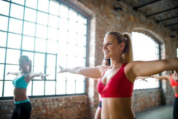 Woman in red sports bra exercising