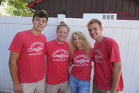 "4 team members wearing dairyhaus ""scoop local"" t-shirt"