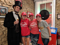 Abraham Lincoln and three team members