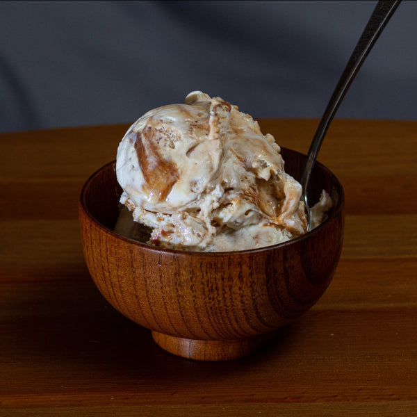 a bowl of salty caramel cashew ice cream