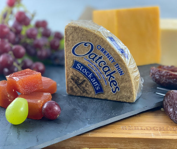 Matthews Cheese - Trio of Truckles, presented on a wooden Cheese board with Orkney Oatcakes