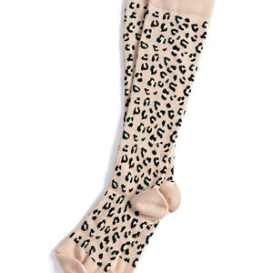 A pair of animal print compression socks open from package.