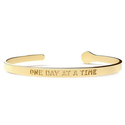 Gold cuff bracelet with the words