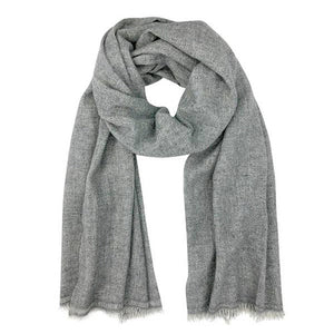 Casual cashmere scarf is a medium grey color is displayed