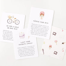 "Load image into Gallery viewer, Self care card deck cards sits on a flat surface.  One reads ""Go for a walk or bike ride and has an illustration of a bike"".  One reads ""pamper your skin"" with an illustration of a woman wearing a towel on her head and a face mask on her face. A third reads ""light your favorite candle"" with an illustration of a candle."