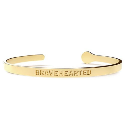 Gold cuff bracelet with the word