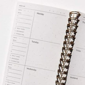Inside pages of a spiral bound planner.