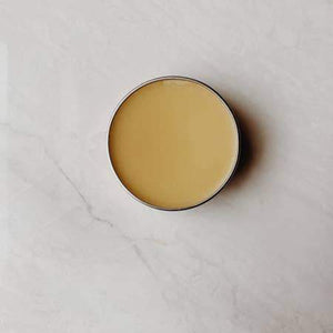 A display photo of muscle balms shows a creamy light balm.