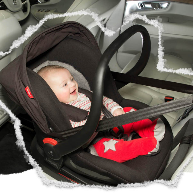 phil&teds alpha car seat with baby inside sitting in car and secured by seatbelts_black/grey marl